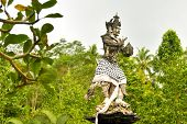 Hindu Statue In Front Of The Balinese Temple. poster