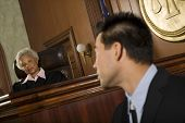 foto of courtroom  - Judge and lawyer looking at each other in courtroom - JPG