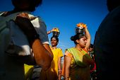 KUALA LUMPUR - JANUARY 27: Hindu devotees carry milk pots or 'pal kodum' as offerings to Lord Muruga walk to the Batu caves temple in Malaysia on January 27, 2013 during the Thaipusam festival.