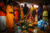 KUALA LUMPUR - JANUARY 27: A Hindu priest prays and blesses devotees before their procession to the