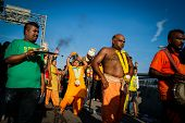 KUALA LUMPUR - JANUARY 27:Hindu devotees perform various acts of devotion to Lord Muruga while walki