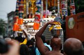 KUALA LUMPUR - JANUARY 26: Hindu devotees carry milk pots or 'pal kodum' as offerings to Lord Muruga