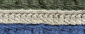 Knit Stitches Background In Cream, White, And Blue