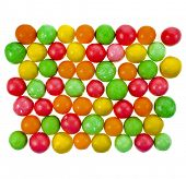 Colored background of assorted candies balls