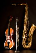 Music Sax tenor saxophone violin and clarinet in black background