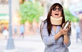 Woman Wearing Neck brace Holding A Shaker, Outdoor