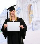 Graduate Woman Holding a blank paper in front of the university building