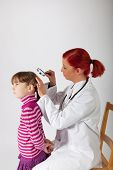 The Pediatrician Examines The Head Of A Little Girl