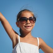 Happy Young Girl Wearing Sunglasses