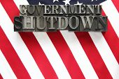 USA flag with government shutdown in metal type