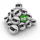 Several balls marked Don't in a pyramid and one with the word Do to illustrate permission, acceptanc