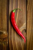 top view of chili pepper on wooden background