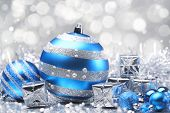 Christmas balls and gifts on abstract background.