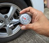 Checking Tire Air Pressure With Meter  Gauge Before Traveling