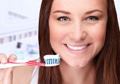 Closeup portrait of attractive female clean teeth in the bathroom, dental clinic, dentistry health care, healthy lifestyle, tooth whitening concept