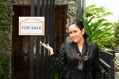 Real estate - Young Indonesian realtor showing an house or apartment, it could be the landlord too
