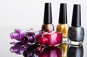foto of nail paint  - Bottles with nail polish over white  background - JPG
