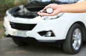pic of air pressure gauge  - Hand holding pressure gauge for car tyre pressure measurement - JPG
