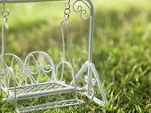 close up of the toy swing