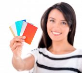 Woman with a handful of credit cards - isolated over white background
