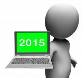 Two Thousand And Fifteen Character And Laptop Shows New Year 2015