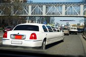 image of limousine  - White wedding limousine on city street outdoors - JPG
