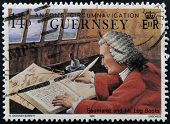 GUERNSEY - CIRCA 1990: A stamp printed in Guernsey shows Admiral James Saumarez and his log books