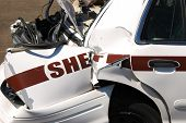 stock photo of rear-end  - The results of a high speed pursuit on a Sheriff patrol car  - JPG