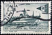 ITALY - CIRCA 1971: stamp printed in Italy shows Packet Tirrenia and postal ensign circa 1971
