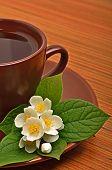 Tea Cup With Jasmine Flower On The Wood
