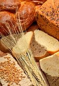 Fresh Bread, Wheat Ears, Wheat Grains On The Wooden Background