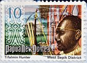 PAPUA NEW GUINEA - CIRCA 1980: A stamp printed in Papua shows Tifalmin Hunter and West Spok District