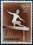 SAN MARINO - CIRCA 1964: A stamp printed in San Marino shows Woman gymnast