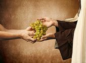 picture of beggar  - Jesus gives grapes to a beggar on beige background - JPG
