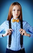 Elegant girl model poses in blouse and bow tie. Fashion shot.