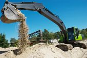excavator machine at excavation work in sand quarry