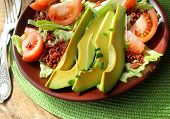 salad with avocado,tomatoes, lettuce,rice