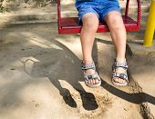 stock photo of swing  - Foot baby swinging on swing at playground - JPG
