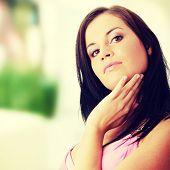 Fashion girl posing in ping dress - portrait