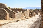 Ancient street in Pompeii, Italy. Summer day
