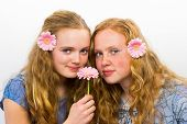 Two girls with pink flower in hair