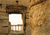 foto of zenobia  - flaking mud columns in the roman city of palmyra in the barren syrian desert - JPG