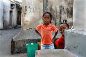 Africa, Tanzania, Zanzibar, Stone Town, Children Play In  Street.
