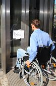 Wheelchair User On Defect Elevator Door