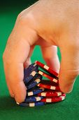 Close up on man's hand doing a poker chip trick