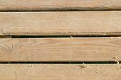 Wooden Slats with some sand