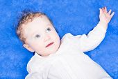 Beautiful Baby Girl With Big Blue Eyes On A Blue Blanket