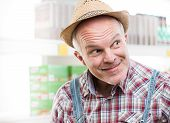 picture of hillbilly  - Funny farmer at supermarket making a face and looking around - JPG