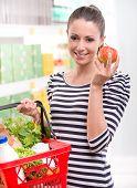 Woman Buying Fresh Fruit At Supermarket