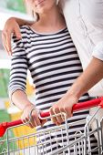 Couple At Supermarket Hands Close-up